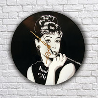 Audrey Hepburn painted retro vinyl clock.
