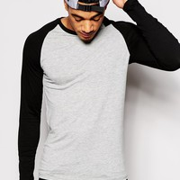 ASOS Extreme Muscle Fit Long Sleeve T-Shirt With Contrast Raglan Sleeves And Stretch at asos.com