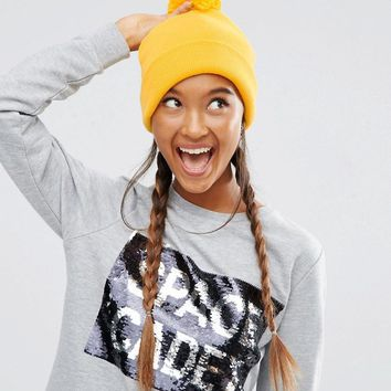ASOS | ASOS Short Turn Up Beanie With Pom In Yellow at ASOS