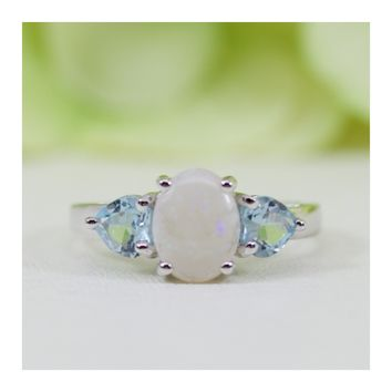 Natural Opal And Natural Blue Topaz Ring In Sterling Silver