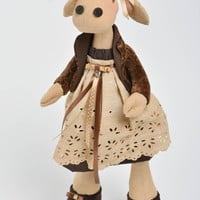 Children's handmade linen and synthetic fabric soft toy cow in beautiful dress