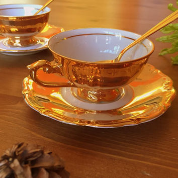Demitasse gold plated coffee/tea cup and saucer with matching tea spoon. Mayer Wiesau, Bavaria.