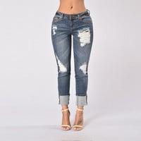 Ripped Distressed Stretch Denim Jeans