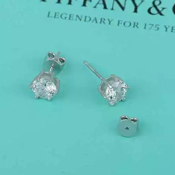 Tiffany & Co. Six claw earrings