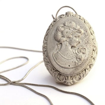 Long beautiful concrete victorian lady medallion cameo necklace.