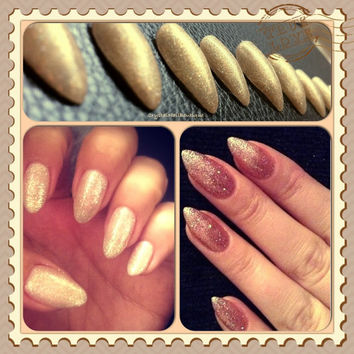 Gold glitter stiletto nails