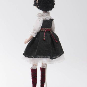 Handmade designer interior fabric soft doll in vintage costume with a stand