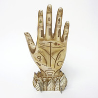 Palmistry Art - Palm Reading Hand Centerpiece Sculpture. Illustration art object using trompe l'oeil, optical illusion for fortune telling.