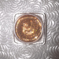 Shade name ( First Base ). Gold bronze loose glitter pigment. 4 grams of product in a jar with sifter and seal. Vegan and cruelty free.