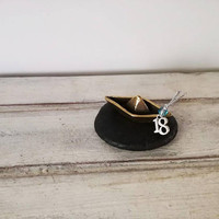 Paperboat brass sculpture, tiny brass sculpture of paperboat with '18' new year charm, paperboat sculpture on black stone, gouri varka '18'
