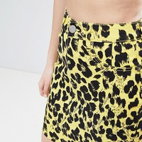 ASOS DESIGN denim original skirt in yellow leopard print at asos.com