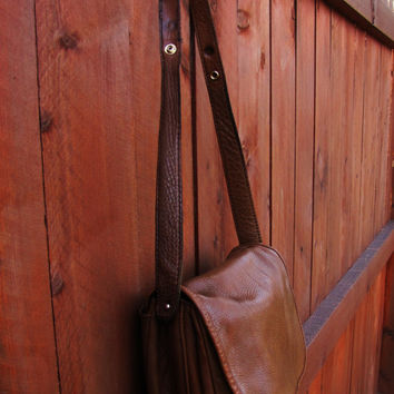 distressed brown leather messenger. convertible handbag to shoulder bag