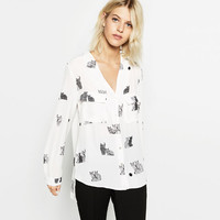 PRINTED BLOUSE WITH PLUNGING NECKLINE DETAILS