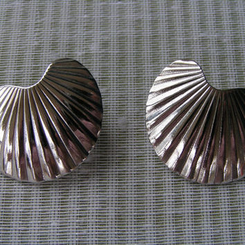 Silver Tone Pierced Earrings, Seashell design, Grooved to catch the sunlight in a gorgeous manner.
