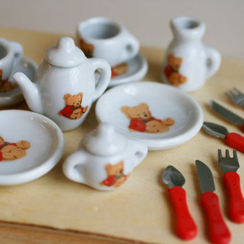 Miniature Set Of Porceline Dishes and Silverware.