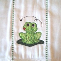 Burp cloth with cute applique frog on lily pad and fly. It can be personalized for an extra charge.