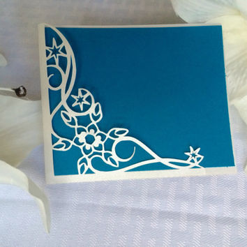 Cut Snowflake winter wedding RSVP pocket card blue with silver shimmer snoflakes blowing in the swirling wind