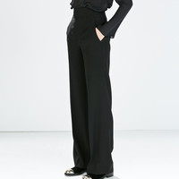 High-waisted wide trousers