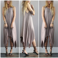 An Asymmetrical Flow Dress in Mocha