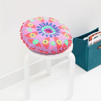 Bombay Duck Embroidered Round Pom Pom Cushion at asos.com