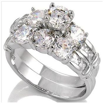 Sterling Silver .75 carat Round cut CZ and Princess cut Channel set Three Stone Wedding ring set 5-9