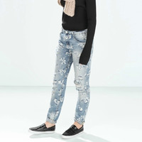 Light Blue Denim Ripped And Frayed Jeans