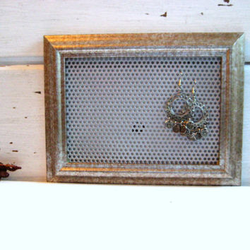 Earring Holder and Jewelry display organizer in a glamorous gold and silver molded frame.
