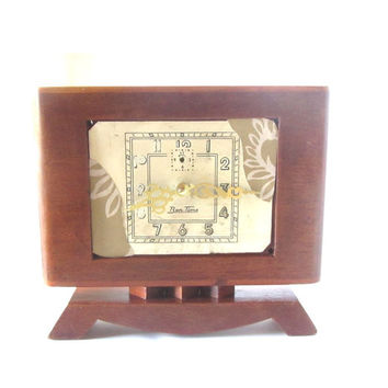 Upcycled shabby mid century wood desk clock. Electronic mechanism installed in a wooden body of a clock from the fifties.