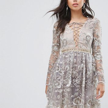True Decadence All Over Embroidered Mini Skater Dress With Lace Up Plunge Front at asos.com
