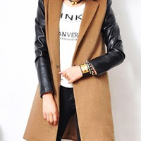 Slim long coat with contrasting sleeves