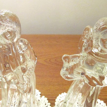 pair of crystal glass Christmas angels playing musical instruments candle holders