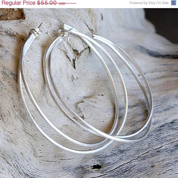 ON SALE Large hoop earrings - Sterling silver hoop earrings with a modern matte finish.