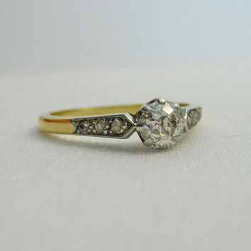 Diamond Engagement Ring, Circa 1910s. Old Mine Cut Diamond in Two Tone Gold Setting.