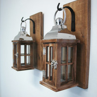 Wood and Glass lantern pair on stained knotty pine boards with wrought iron hooks rustic wall decor cabin decor