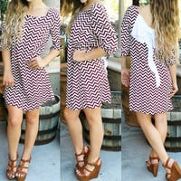 TO THE BEAT BOW BACK CHEVRON DRESS IN WINE/WHITE MULTI