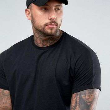 ASOS Super Oversized Longline T-Shirt With Roll Sleeve In Black at asos.com