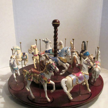 Porcelain Carousel horses on  tabletop rotating wooden platform, Franklin Mint 1988 Horses hand painted with gold trim