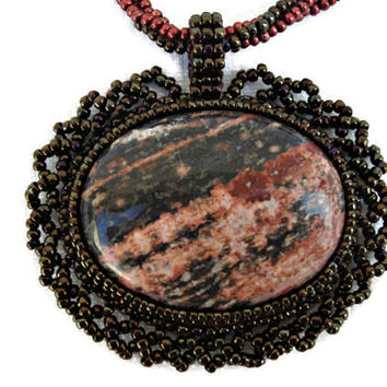 Bead Embroidery Pendant necklace with a Leopard Skin Jasper cabochon.