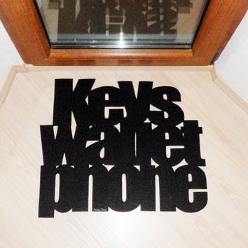 "Design door mat ""Keys Wallet Phone"". Personalized rug."