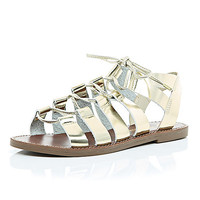 Metallic gold gladiator sandals - flat sandals - shoes / boots - women