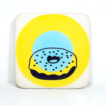 tile with a donut on yellow & sky blue colour block target, ready to go.