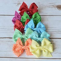 Hair bows for babies, toddler and girls in a 3 inch pinwheel style and available in 32 vibrant colors.