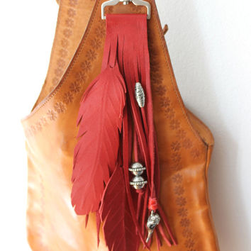 Red leather feathers bird skull silver beads handmade bag charm fringe