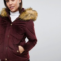 Lipsy Velvet Puffer Jacket With Faux Fur Hood And Gold Trims at asos.com