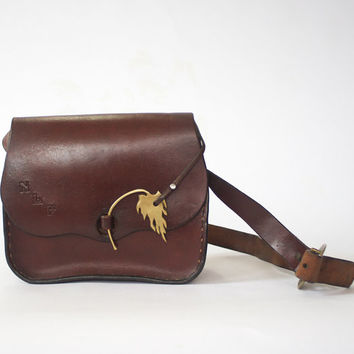 vintage leather purse with brass leaf / 70s brown leather bag