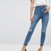 ASOS FARLEIGH High Waist Slim Mom Jeans In Hawthorn Mid Stonewash with Busted Knees and Let-Down Hems at asos.com