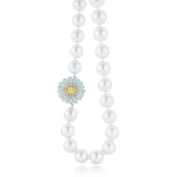 Tiffany & Co. - Daisy pearl necklace in platinum and 18k gold with white and yellow diamonds.