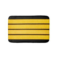 Yellow stripes on black bath mat