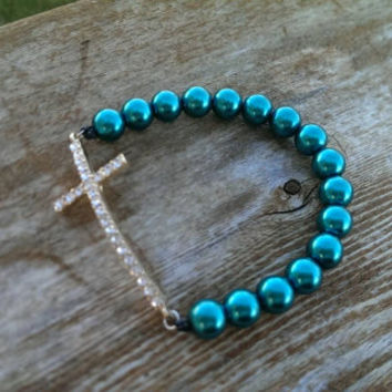 Gold & rhinestone cross and colored pearl beaded stretch bracelet