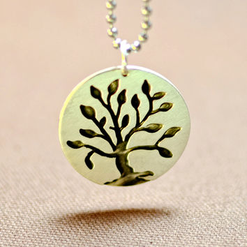 Sterling silver silhoutte tree medallion